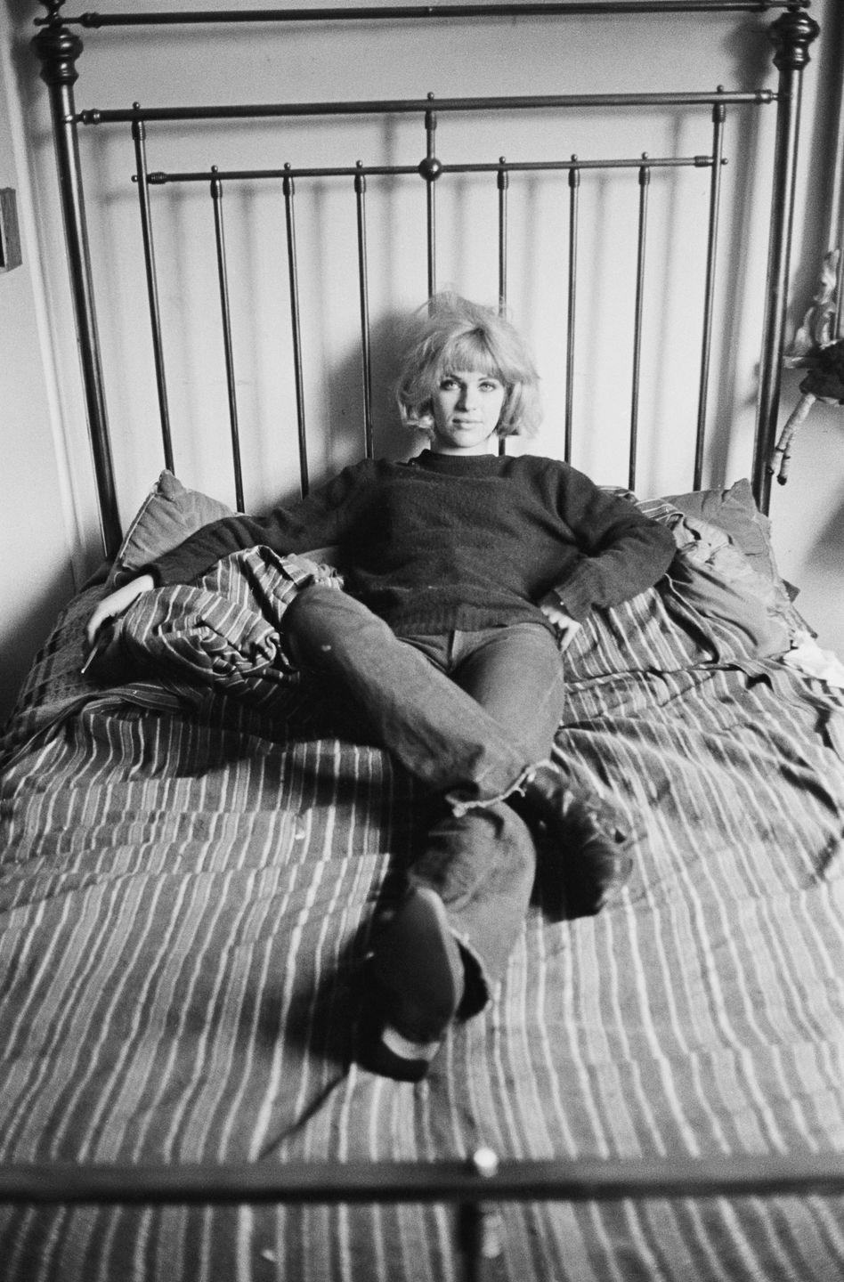 <p>Pauline Boty, the only female member of the British pop artist movement, kicks back in her bootcut pair. (Note the raw, unfinished hem.) </p>