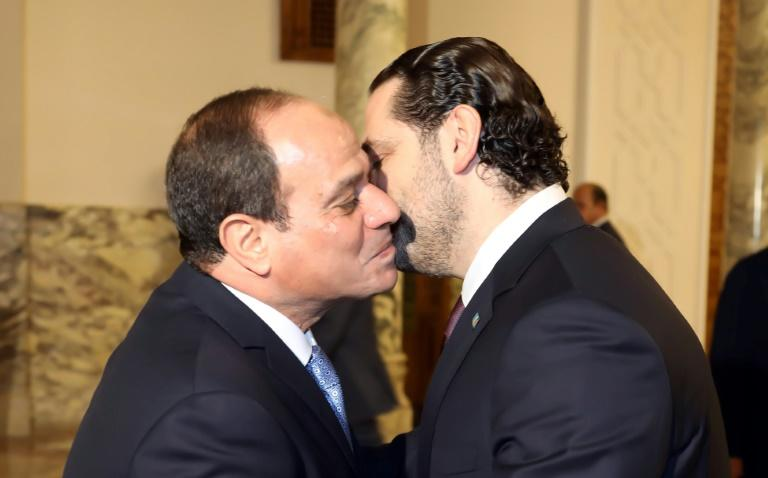 A handout picture provided by the Lebanese photo agency Dalati and Nohra on November 21, 2017 shows Lebanese Prime Minister Saad Hariri (R) being greeted by Egyptian President Abdel Fattah al-Sisi (L) upon his arrival in Cairo
