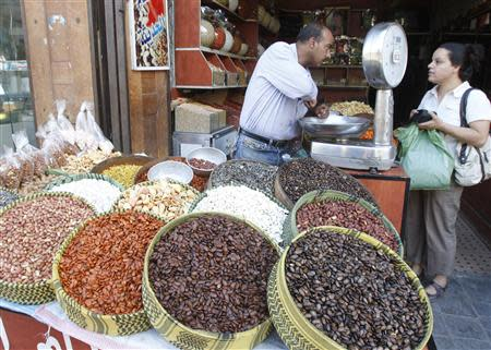 A Syrian woman buys seeds at a market in old Damascus, September 10, 2013. REUTERS/Khaled al-Hariri