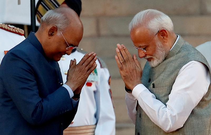 India's President Ram Nath Kovind greets India's Prime Minister Narendra Modi after his oath during a swearing-in ceremony at the presidential palace in New Delhi, India May 30, 2019. REUTERS/Adnan Abidi