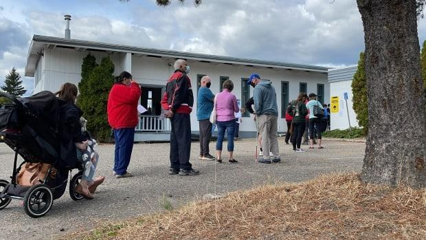 Voters line up outside Trinity United Church on Sept. 13. People wanting to cast a ballot were waiting between 45 and 90 minutes at some sites.  (Andrew Kurjata/CBC - image credit)