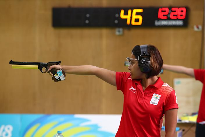 India's Heena Sidu competes during the women's 10m air pistol competition at the 2018 Gold Coast Commonwealth Games at the Belmont Shooting Complex in Brisbane on April 8, 2018. / AFP PHOTO / Patrick HAMILTON / The erroneous mention[s] appearing in the metadata of this photo by Patrick HAMILTON has been modified in AFP systems in the following manner: [Heena Sidu] instead of [Manu Bhaker]. Please immediately remove the erroneous mention[s] from all your online services and delete it (them) from your servers. If you have been authorized by AFP to distribute it (them) to third parties, please ensure that the same actions are carried out by them. Failure to promptly comply with these instructions will entail liability on your part for any continued or post notification usage. Therefore we thank you very much for all your attention and prompt action. We are sorry for the inconvenience this notification may cause and remain at your disposal for any further information you may require.        (Photo credit should read PATRICK HAMILTON/AFP via Getty Images)