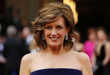 Co-Chair of Disney Media and President of the Disney/ABC Television Group Anne Sweeney arrives on the red carpet at the 86th Academy Awards in Hollywood
