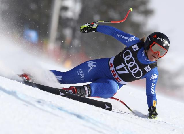 FILE - In this March 15, 2018 file photo, Italy's Sofia Goggia speeds down the course during a women's super-G at the alpine ski World Cup finals in Are, Sweden. A spokesman for the Italian Winter Sports Federation said on Wednesday, Jan. 16, 2019 that Goggia is planning to return from injury later this month and will participate in downhill training in Garmisch-Partenkirchen, Germany, beginning Jan. 24 with an eye toward competing in downhill and super-G races at the German resort on Jan. 26 and 27, respectively. (AP Photo/Alessandro Trovati, file)