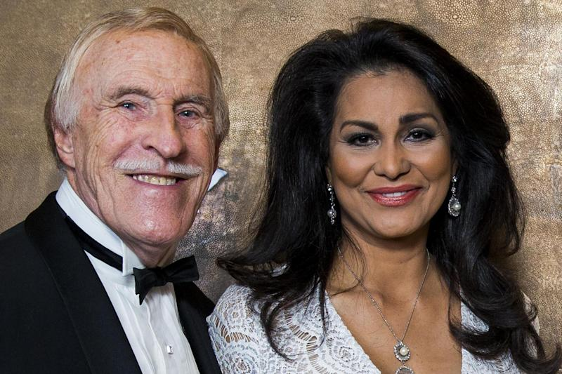 Returning home from hospital: Sir Bruce Forsyth with his wife Wilnelia Forsyth (file photo): Getty Images