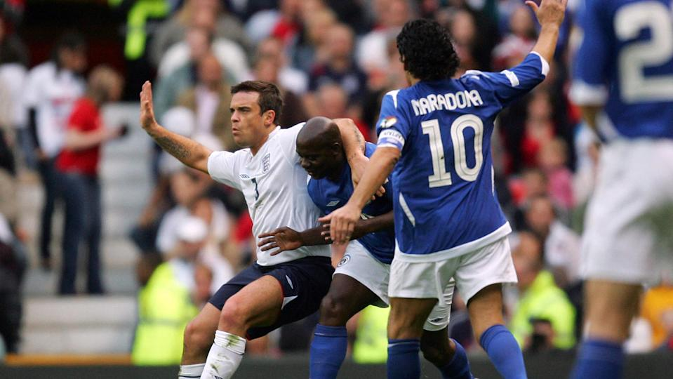 Ben Shephard and Robbie Williams both love to remember the moment they played against Maradona at Old Trafford (Image: Getty Images)