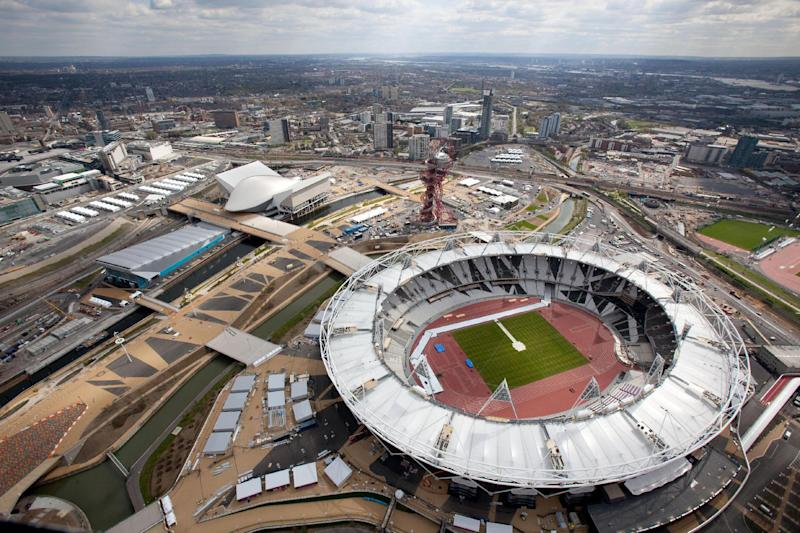 "FILE This Monday April 16, 2012 file photo provided by LOCOG shows an aerial view of the Olympic Park showing the London 2012 Olympic Stadium, foreground and the Aquatics Center, white building at left.  London will be the social media Olympics. For all the history and tradition associated with London, a very modern-day phenomemon will play a prominent role at the upcoming Summer Games. Tweet this: These will be the first Olympics told in 140 characters or less. The London Games will be the most tweeted, micro-blogged, liked and tagged in history, with fans offered a never before seen insider's view of what many are calling the social media Olympics, or the ""socialympics."" (AP Photo/Anthony Charlton/LOCOG)"