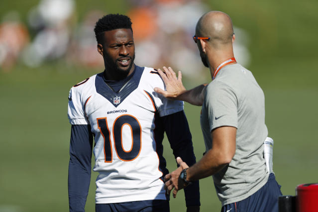 FILE - In this Tuesday, Aug. 6, 2019, file photograph, Denver Broncos wide receiver Emmanuel Sanders, (10) confers with wide receiver coach Zach Azzanni during an NFL football training camp session in Englewood, Colo. Emmanuel Sanders' comeback was more complex than most people realized. The Denver Broncos' 32-year-old receiver revealed this week that he had surgeries on both ankles in the offseason, one to repair his left Achilles tendon which he tore in practice last December and one on his right ankle a month later.(AP Photo/David Zalubowski, File)