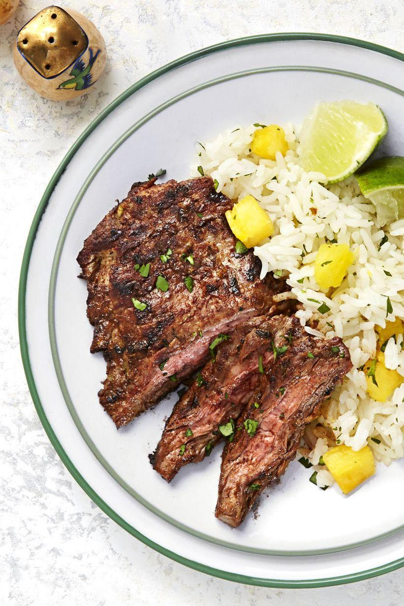 """<p><a href=""""https://www.goodhousekeeping.com/food-recipes/g2346/steak-recipes/"""" rel=""""nofollow noopener"""" target=""""_blank"""" data-ylk=""""slk:Steak should be a weeknight thing"""" class=""""link rapid-noclick-resp"""">Steak <em>should </em>be a weeknight thing</a>, right? We say yes, so we came up with this skirt steak recipe that's ready in 20 minutes flat. You're welcome. </p><p><em><a href=""""https://www.goodhousekeeping.com/food-recipes/a32407/chili-steak-hawaiian-rice-recipe-ghk0515/"""" rel=""""nofollow noopener"""" target=""""_blank"""" data-ylk=""""slk:Get the recipe for Chili Steak with Hawaiian Rice »"""" class=""""link rapid-noclick-resp"""">Get the recipe for Chili Steak with Hawaiian Rice »</a></em> </p>"""