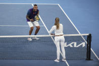 Australia's Nick Kyrgios reacts as he speaks with umpire Marijana Veljovic regarding the net during his match against France's Ugo Humbert during their second round match at the Australian Open tennis championship in Melbourne, Australia, Wednesday, Feb. 10, 2021. (AP Photo/Hamish Blair)