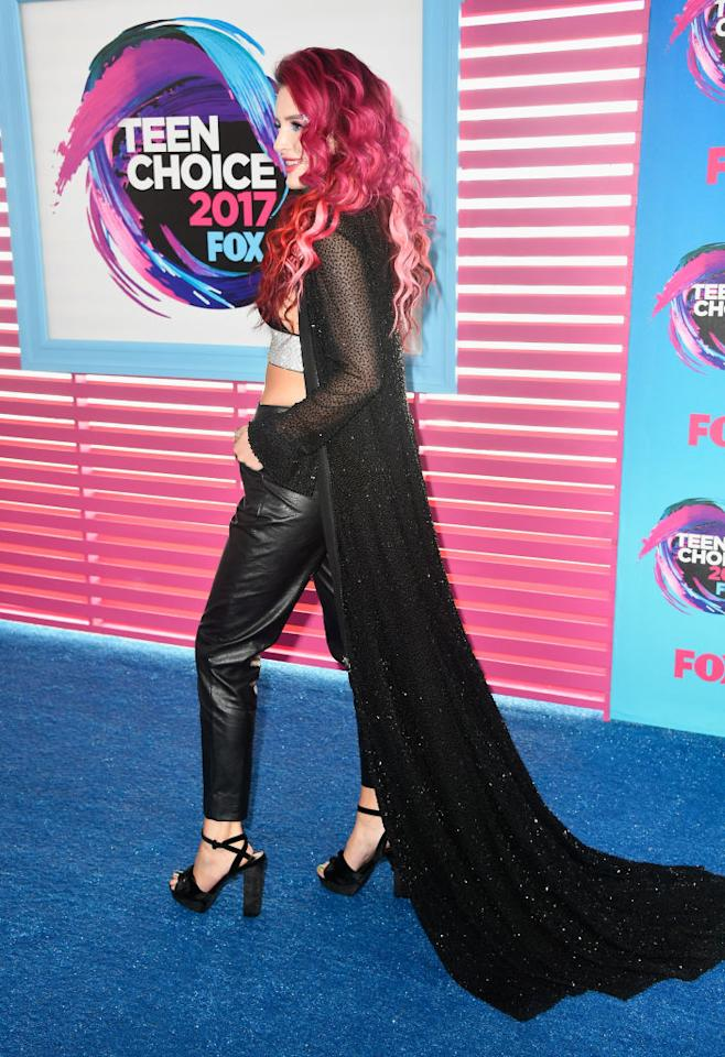 <p>Yes, she's wearing a cape. And rocking hot pink hair. (Photo: Getty Images) </p>