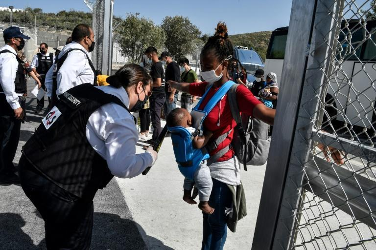A double barbed-wire fence surrounds the camp on Samos island, a facility for 3,000 people that also has surveillance cameras, X-ray scanners and magnetic doors (AFP/LOUISA GOULIAMAKI)