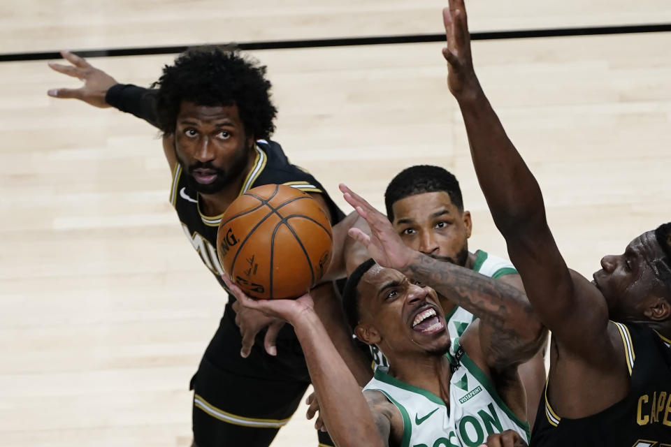 Boston Celtics guard Jeff Teague (55) goes up for a shot against Atlanta Hawks center Clint Capela (15) in the second half of an NBA basketball game Wednesday, Feb. 24, 2021, in Atlanta. (AP Photo/John Bazemore)