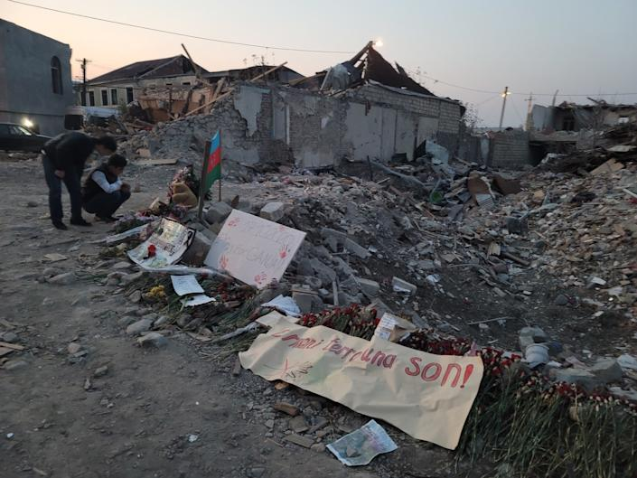 Children gather at the site of a missile barrage in the city of Ganja, Azerbaijan.