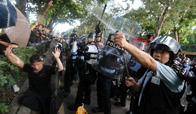 Police fire pepper spray at demonstrators during extradition bill protests. Photo: Felix Wong
