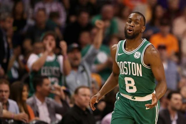 Kemba Walker of the Boston Celtics (pictured November 18, 2019) collided head first into his teammate's stomach during the first half (AFP Photo/Christian Petersen)