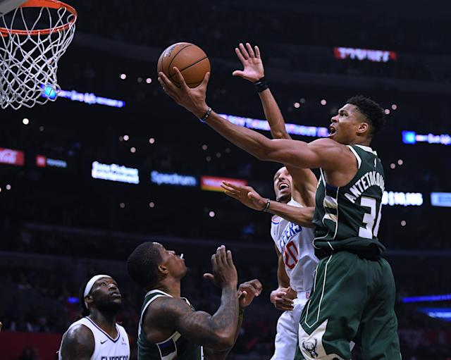 Giannis Antetokounmpo scores on a layup past the Clippers' Landry Shamet (20) on Wednesday night. (Photo by Harry How/Getty Images)