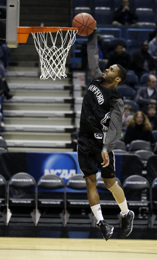 Wofford guard Karl Cochran goes to the basket during a practice session for their NCAA college basketball tournament game Wednesday, March 19, 2014, in Milwaukee. Wofford plays Michigan on Thursday, March 20, 2014. (AP Photo/Morry Gash)