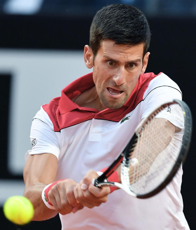 Novak Djokovic of Serbia returns the ball to Albert Ramos Vinolas of Spain, at the Italian Open tennis tournament in Rome, Thursday, May 17, 2018 (Ettore Ferrari/ANSA via AP)