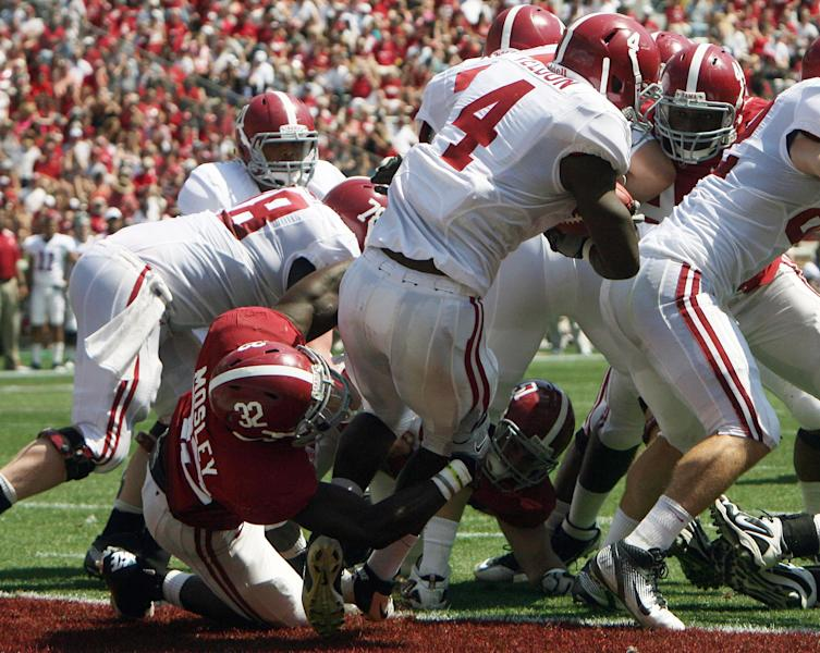 Crimson team linebacker C.J. Mosley (32) tackles White team running back T.J. Yeldon (4) in the end zone during the A-Day game at Bryant-Denny Stadium in Tuscaloosa, Ala. Saturday, April 14, 2012. (AP Photo/Tuscaloosa News, Michelle Lepianka Carter)