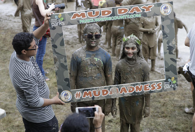<p>Kids pose for a photo during Mud Day at the Nankin Mills Park, July 11, 2017 in Westland, Mich. (Photo: Carlos Osorio/AP) </p>