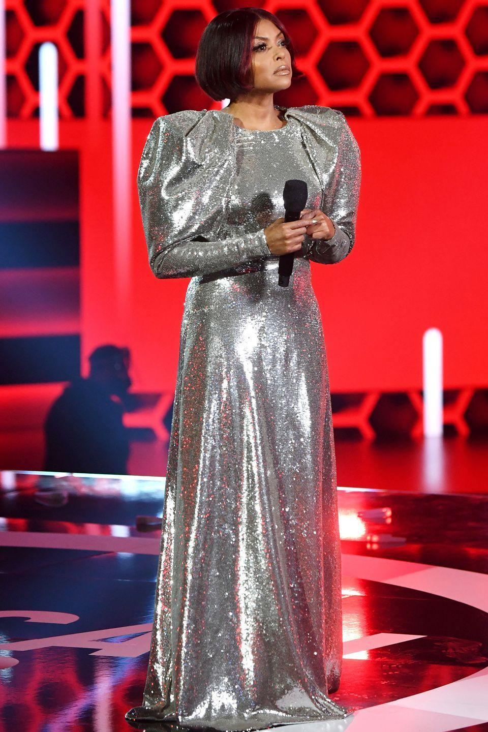 <p><strong>22 November </strong>Henson also dressed for the festive season in this silver Carolina Herrera gown. </p>