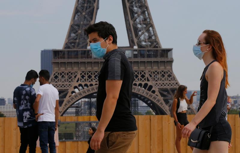 <strong>People wearing masks to prevent the spread of Covid-19 walk at Trocadero plaza near Eiffel Tower in Paris, Saturday, August 8.</strong> (Photo: ASSOCIATED PRESS)
