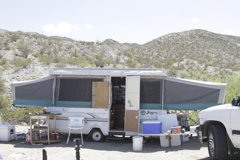 An trailer used by members of the United Constitutional Patriots sits a quarter mile from a barrier that marks the U.S.-Mexico border Tuesday, April 23, 2019, in Sunland Park, N.M., hours before its occupants were evicted by police. Members of the United Constitutional Patriots gained national attention after filming themselves detaining immigrants who cross the border to the east where the wall ends. (AP Photo/Cedar Attanasio)