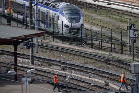 A new Regiolis regional train made by power and train-making firm Alstom, is seen next to a platform at Strasbourg's railway station, May, 21, 2014. REUTERS/Vincent Kessler