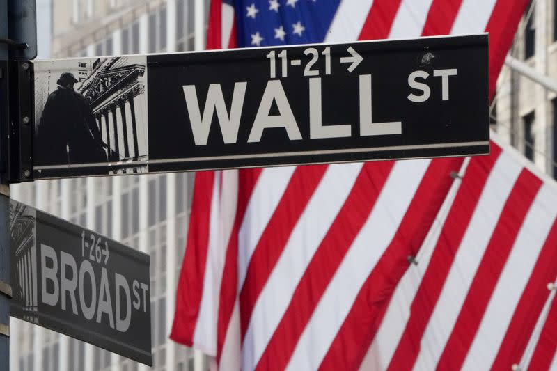 FILE PHOTO: The Wall Street sign is pictured at the New York Stock exchange (NYSE) in the Manhattan borough of New York City, U.S.