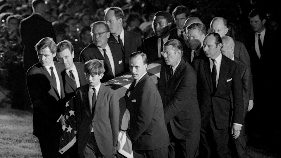 Rafer Johnson, pictured here helping to carry the coffin of Robert Kennedy at his funeral in 1968.