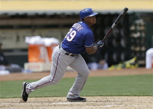 Texas Rangers' Adrian Beltre watches his RBI single off Oakland Athletics' Dan Straily in the fifth inning of a baseball game Wednesday, May 15, 2013, in Oakland, Calif. (AP Photo/Ben Margot)