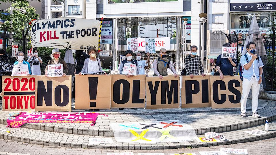 In this picture, protesters in Tokyo call on the Olympic Games to be cancelled.