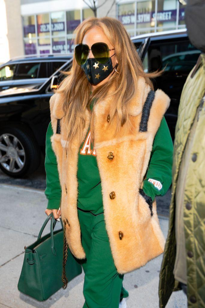 <p>Jennifer Lopez wore a festive-coloured tracksuit while out in in New York City on December 28, ahead of her upcoming performance on Dick Clark's New Year's Rockin' Eve with Ryan Seacrest. </p><p> The singer paired her green athleisurewear with a thick camel-coloured furry vest and a forest-hued Hermès Birkin bag. A star-printed mask and dark green tinted sunglasses finished off the look. </p>