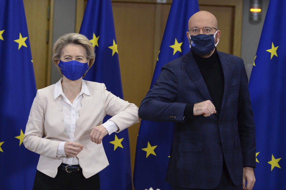European Commission President Ursula von der Leyen, left, and European Council President Charles Michel bump elbows after signing the EU-UK Trade and Cooperation Agreement at the European Council headquarters in Brussels, Wednesday, Dec. 30, 2020. European Union's top officials have formally signed the post-Brexit trade deal sealed with the United Kingdom. European Commission president Ursula von der Leyen and European Council president Charles Michel put pen to paper on Wednesday morning during a brief ceremony in Brussels (Johanna Geron, Pool Photo via AP)