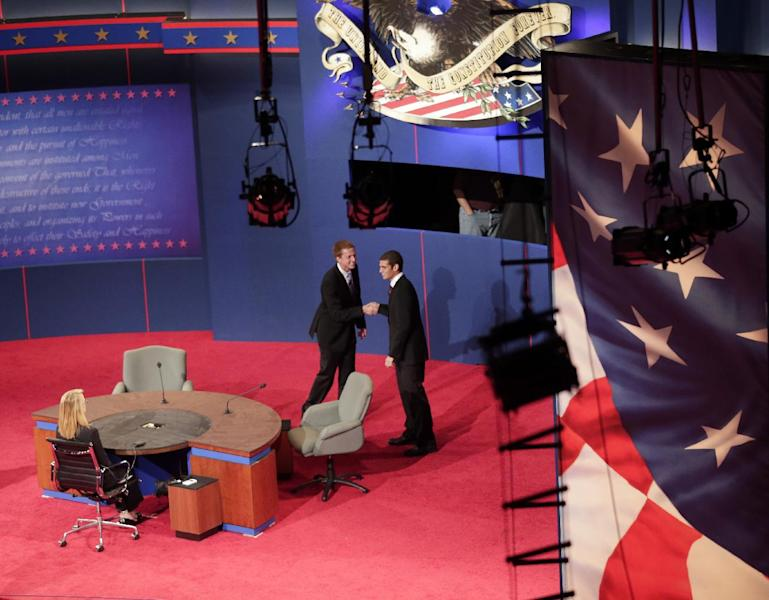 Students posing as Vice President Joe Biden, and Republican vice presidential candidate, Rep. Paul Ryan, R-Wis., shake hands during set up for Thursday's vice presidential debate, Wednesday, Oct. 10, 2012, at Centre College in Danville, Ky. (AP Photo/Morry Gash)
