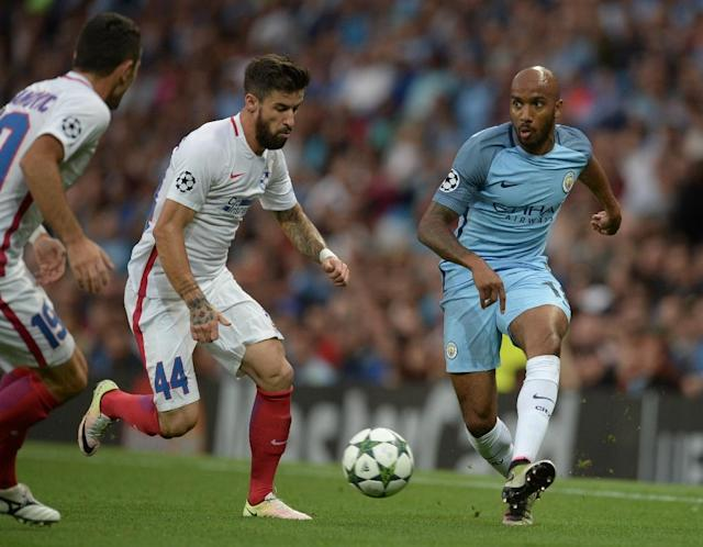 Manchester City's midfielder Fabian Delph (R) plays the ball under pressure from Steaua Bucharest's midfielder Gabriel Enache (C) during a UEFA Champions League second leg play-off football match on August 24, 2016 (AFP Photo/Oli Scarff)