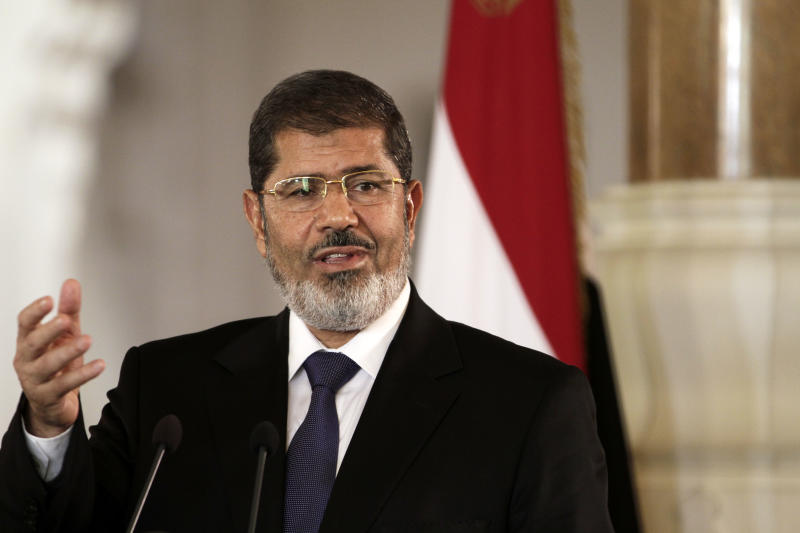 FILE - In this Friday, July 13, 2012 file photo, Egyptian President Mohammed Morsi holds a joint news conference with Tunisian President Moncef Marzouki, unseen, at the Presidential palace in Cairo, Egypt. In a posting Saturday, April 20, 2013 on his official Twitter account, Morsi promised to reshuffle the Cabinet and appoint new governors. (AP Photo/Maya Alleruzzo, File)