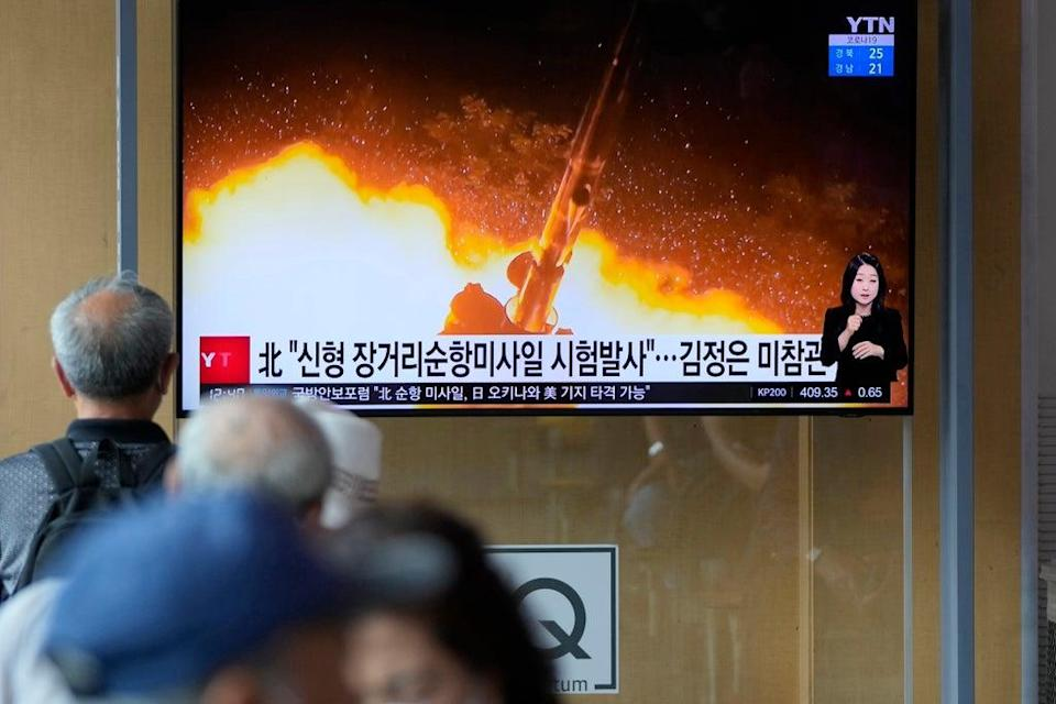Seoul residents watch a news show featuring a North Korean handout photo captioned, 'North Korea's long-range cruise missiles tests' (AP)