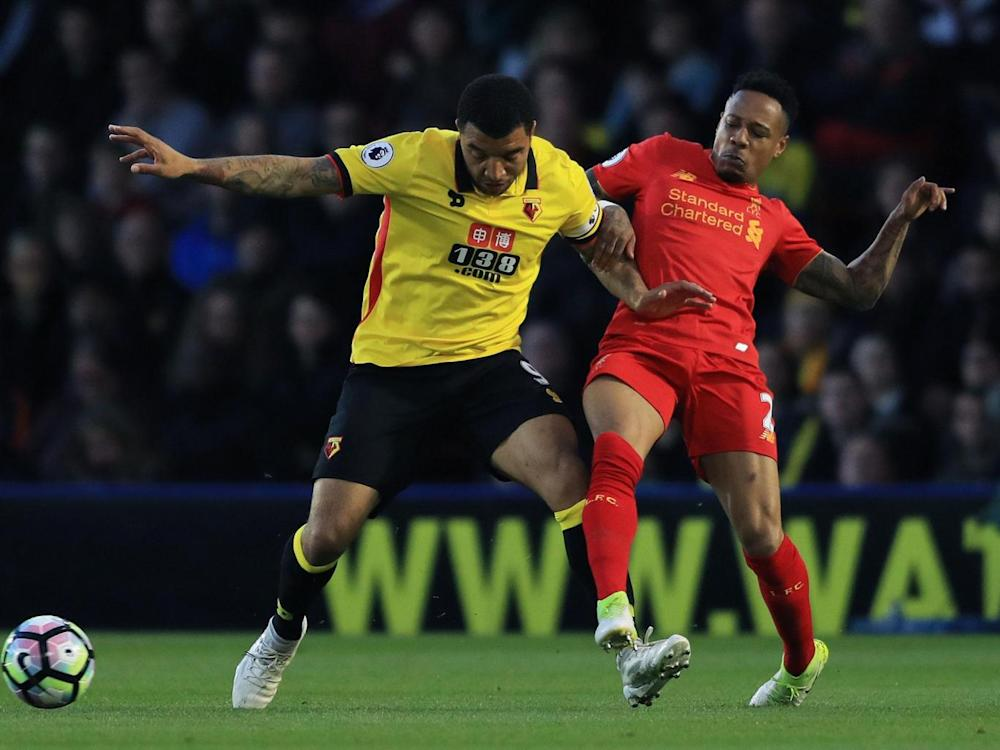 Deeney attempts to hold off Clyne (Getty)