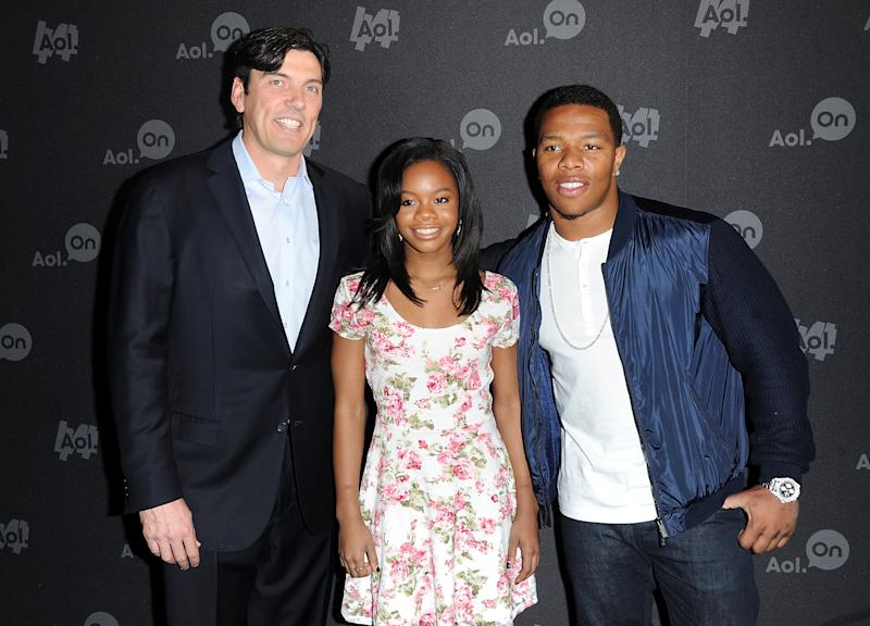 """AOL CEO Tim Armstrong, Olympic gymnast Gabby Douglas and NFL football player Ray Rice attend AOL's web series """"NewFront"""" at Moynihan Station on Tuesday April 30, 2013 in New York. (Photo by Evan Agostini/Invision/AP)"""