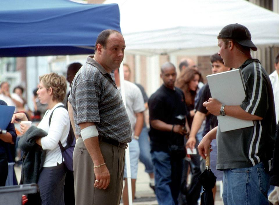 <p>Gandolfini takes direction from a crew member while shooting in Belleville, New Jersey.</p>