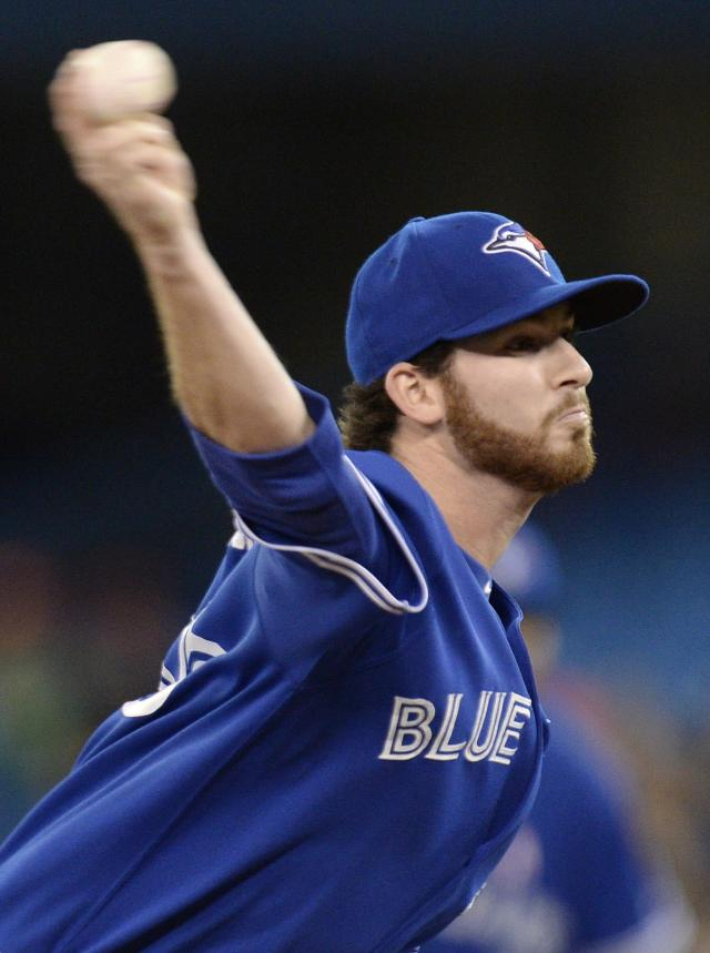 Toronto Blue Jays starting pitcher Drew Hutchison works against the Los Angeles Angels during first-inning baseball game action in Toronto, Sunday, May 11, 2014. (AP Photo/The Canadian Press, Frank Gunn)