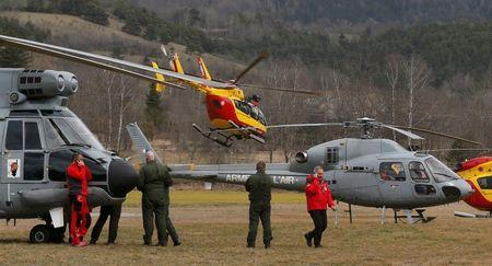 Rescue helicopters from the French Securite Civile and the Air Force are seen in front of the French Alps during a rescue operation near to the crash site of an Airbus A320, near Seyne-les-Alpes, March 24, 2015.   REUTERS/Jean-Paul Pelissier