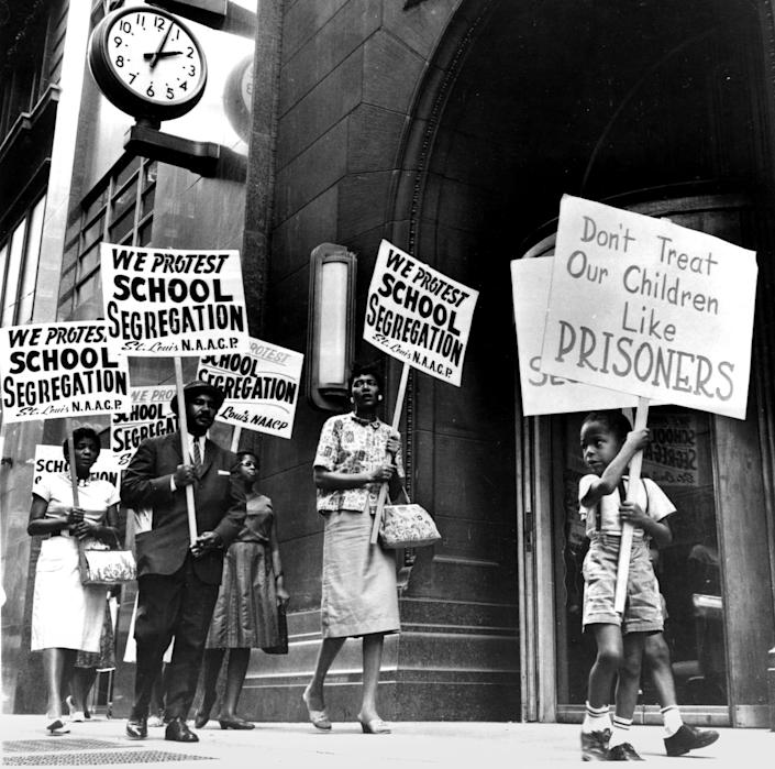 Demonstrators picket in front of a school board office in protest of segregation, in St. Louis, Mo., early 1960s. (PhotoQuest / Getty Images file)