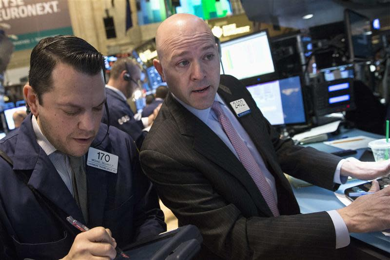 Goldman Sachs Sr. floor trader Jay Woods works at the post that trades RadioShack, on the floor of the New York Stock Exchange