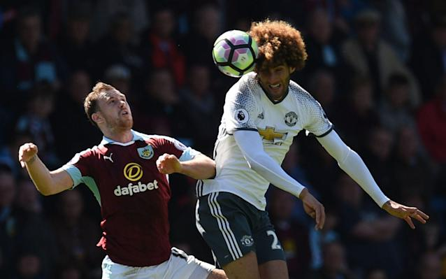 <span>Barnes challenges Fellaini</span> <span>Credit: AFP </span>