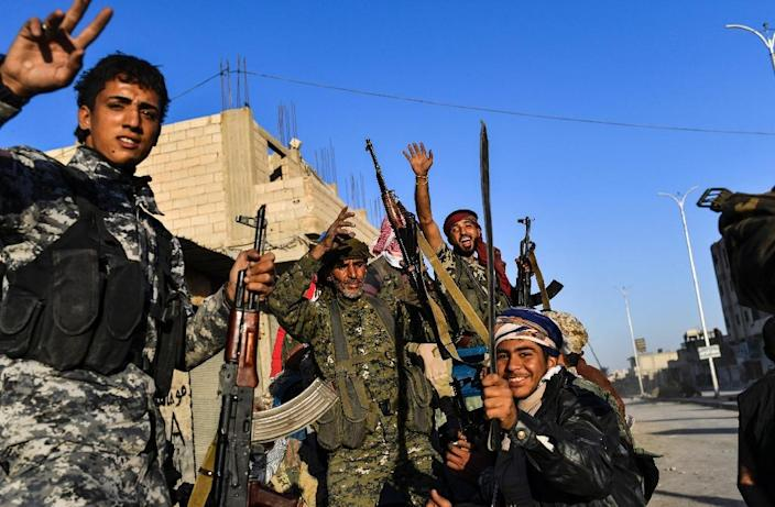 """Members of the Syrian Democratic Forces (SDF), who US forces say have captured """"hundreds"""" of foreign-born Islamic State militants on the Syrian battlefield, including two British men who belonged to the notorious """"Beatles"""" kidnapping and murder group (AFP Photo/BULENT KILIC)"""