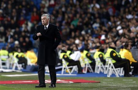 Real Madrid's coach Carlo Ancelotti gestures during their Spanish First Division soccer match against Real Valladolid at Santiago Bernabeu stadium in Madrid November 30, 2013. REUTERS/Susana Vera