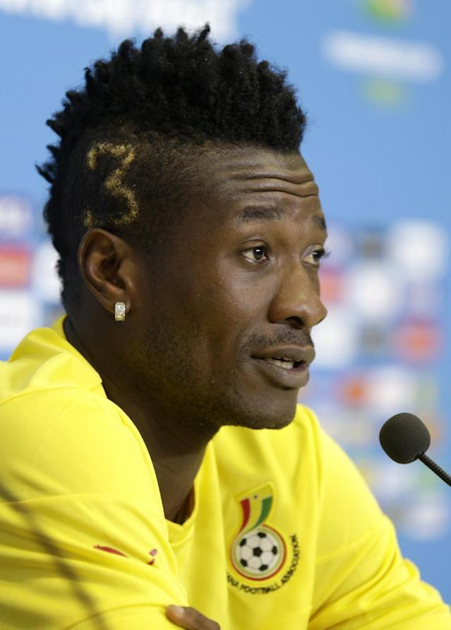 Ghana's Asamoah Gyan attends a press conference before an official training session the day before the group G World Cup soccer match between Ghana and the United States at the Arena das Dunas in Natal, Brazil, Sunday, June 15, 2014. (AP Photo/Dolores Ochoa)